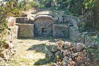 A haka, or family tomb, of the turtle-back variety.