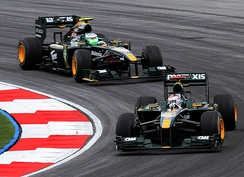 Jarno Trulli leads Heikki Kovalainen during practice for the 2010 Malaysian Grand Prix.
