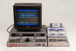 The NES Test station (Lower Left), SNES counter tester (Lower Right), SNES test cart (Upper Right), And the original TV that came with the unit (Upper Left).