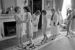 First Lady Nancy Reagan greets Dole and other Senate wives in the Blue Room. 1988