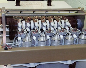 A bank of six 2000 A thyristors (white disks arranged in a row at top, and seen edge-on)