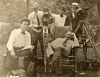 1919 film crew (from left): Thomas Walsh (assistant director), Ned Van Buen (camera operator), Edward James (assistant director), Edward Wynard (camera operator), Neill (director, seated)