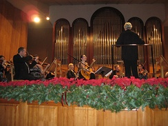 The Sochi Symphony Orchestra conducted by Oleg Soldatov during a concert with the Austrian guitarist Johanna Beisteiner at Organ and Chamber Music Hall in Sochi (December 13, 2013)