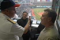 Indians TV announcer Matt Underwood (seated, center) and longtime lead radio announcer Tom Hamilton (right)