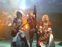 Versailles performing in 2010, wearing costumes similar to the French Rococo style.