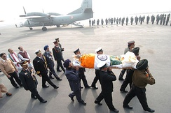 The three wings of India's military services, carrying the mortal remains of P. V. Narshima Rao towards service aircraft at Palam Airport, New Delhi on 24 December 2004 for onward journey to Hyderabad where cremation was performed.