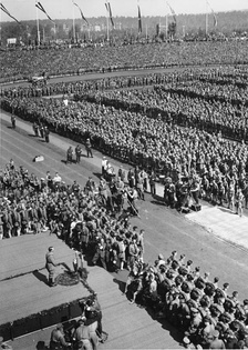 Hitler was the focal point at the 1934 Nuremberg Rally. Leni Riefenstahl and her crew are visible in front of the podium.