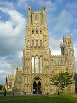 Ely Cathedral, England, the central western tower and framing smaller towers all had transitional features, 1180s. The tower to the left fell. Gothic porch, 1250s; lantern, 1390s.