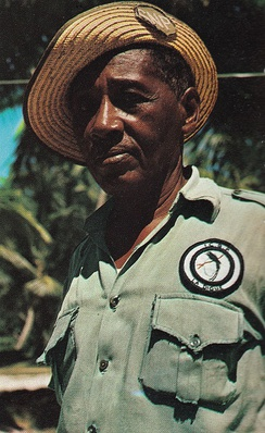 A warden with a ICBP mark on his uniform on La Digue, Seychelles in the 1970s