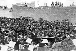 The Israel Philharmonic Orchestra performs in the desert town of Beersheba, 1948.