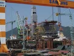 The world's largest oil and gas project, Sakhalin II- Lunskoye platform under construction. The topside facilities of the LUN-A (Lunskoye) and PA-B (Piltun Astokhskoye) platforms are being built at the Samsung Heavy Industry shipyard in South Korea.[132]