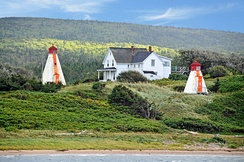Range Lights in Margaree Harbour, Nova Scotia. When the vessel is on the correct course, the two lights line up above one another.
