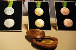 The medals designed for the Olympics. They were designed to be environmentally friendly from recycled materials.