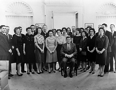 President John F. Kennedy (seated) with members of his White House staff