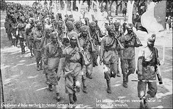 Postcard of marching Sikhs with rifles