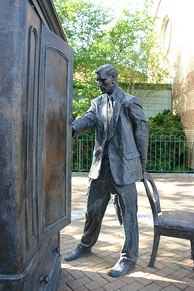 Ross Wilson's statue of C. S. Lewis in front of the wardrobe from his book The Lion, the Witch and the Wardrobe in East Belfast