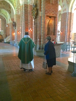 A Lutheran priest of the Church of Sweden prepares for the celebration of Mass in Strängnäs Cathedral.
