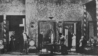 "In Stanislavski's production of The Cherry Orchard (Moscow Art Theatre, 1904), a three-dimensional box set gives the illusion of a real room. The actors act as if unaware of the audience, separated by an invisible ""fourth wall"", defined by the Proscenium arch."