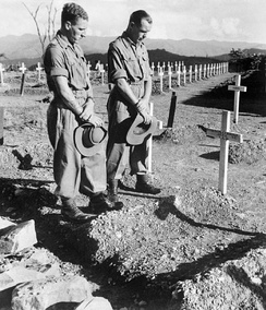 Two soldiers visit the Military Cemetery at Kohima to pay their respects to their former comrade Lance Corporal John Harman VC, 1945