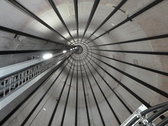 Inside view of a wind turbine tower, showing the tendon cables