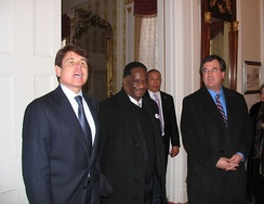 Blagojevich (left) with Emil Jones (center) and Jeffrey Schoenberg (right) at the Illinois Executive Mansion for a luncheon after Barack Obama launched his 2008 campaign in 2007.