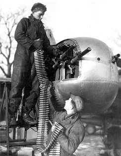 Reloading machine guns on an A-26B with a six-gun nose