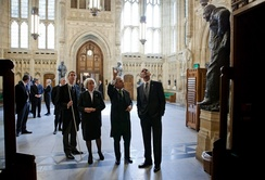 US President Barack Obama (right) in the Members' Lobby during a tour of the Palace in May 2011. With him are, from the left: the Lord Great Chamberlain, the Marquess of Cholmondeley, holding his white staff of office; the Lord Speaker, Baroness Hayman; and the Speaker of the House of Commons, John Bercow.