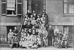"Bell, top right, providing pedagogical instruction to teachers at the Boston School for Deaf Mutes, 1871. Throughout his life, he referred to himself as ""a teacher of the deaf""."