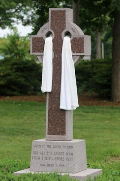 Celtic cross draped for Easter at a Presbyterian church