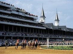 The Kentucky Derby in progress at Churchill Downs.