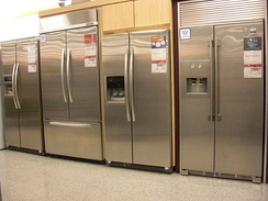Display of modern American-style / side-by-side refrigerators, available for purchase in a store