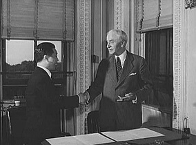 Hull and Chinese Ambassador Wei Daoming at the State Department exchanging ratifications of the treaty abolishing extraterritorial rights of the United States in China.