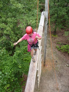 A Venturer traverses a COPE High Ropes course.