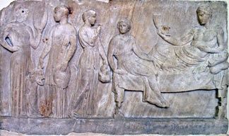 Relief, now in Athens, showing Dionysus with actresses (possibly from The Bacchae) carrying masks and drums