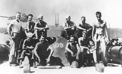 Lieutenant (junior grade) Kennedy (standing at right) with his PT-109 crew, 1943