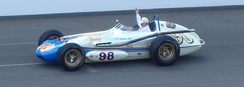 Jones drives the car he drove in the Indianapolis 500 from 1961 through 1964 around the Indianapolis Motor Speedway track in 2012.