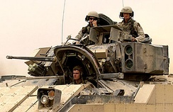 U.S. Army soldiers head out on a mission in their M2A2 ODS, seen here fitted with explosive reactive armor boxes, Iraq, October 2004
