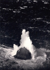 Unusually large winter waves breaking over the islet, 11 March 1943