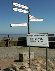 Signpost in the harbour of Smygehuk, Sweden's southernmost point