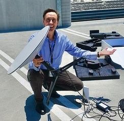 SpaceX board member Steve Jurvetson holding a Starlink user terminal.