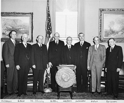 Attendees at the swearing in of Secretary of the Smithsonian Institution Leonard Carmichael in 1953. Senator Clinton P. Anderson is at left.