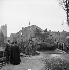 A Challenger tank crosses a Bailey bridge over the Dommel river in Sint-Michielsgestel, the Netherlands. 27 October 1944.