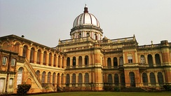 The rear side of Cooch Behar Palace, which retains the original color of the monument.[2]
