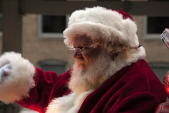 Santa Claus waves to children from an annual holiday train in Chicago, 2012.