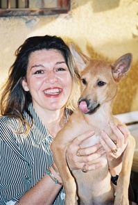 Amina Tharwat Abaza –  Animal rights activist. Founder of Society for Protection of Animal Rights in Egypt holding a street dog.