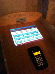 Kollektomat (collectomat), an automatic offertory machine with a card reader in Lund Cathedral, Sweden