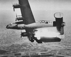A USAAF B-24 hit by flak over Italy, 10 April 1945.