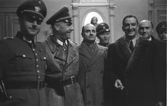 German-Vichy French meeting at Marseille in 1943. SS-Sturmbannführer Bernhard Griese, Marcel Lemoine (regional préfet), Mühler (Commander of Marseille Sicherheitspolizei), -laughing- René Bousquet (General Secretary of the French National Police created in 1941) creator of the GMRs, -behind- Louis Darquier de Pellepoix (Commissioner for Jewish Affairs).
