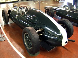 A rear three-quarter picture of a Cooper T51, the first World Championship-winning mid-engined Formula One car