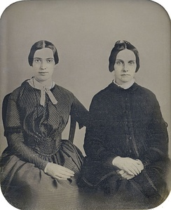 In September 2012, the Amherst College Archives and Special Collections unveiled this daguerreotype, proposing it to be Dickinson and her friend Kate Scott Turner (ca. 1859); it has not been authenticated.[54]